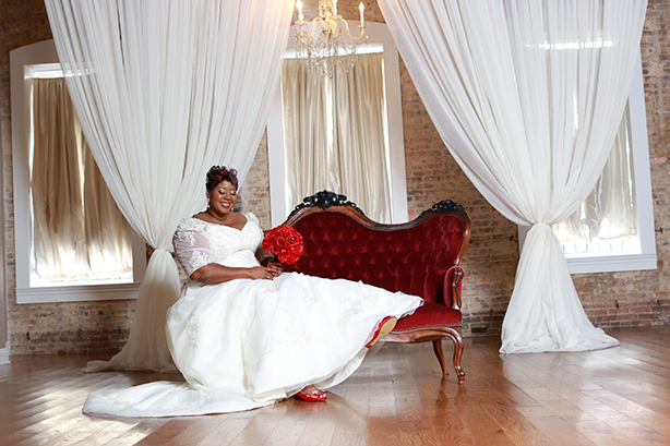 person posing on couch for wedding photo
