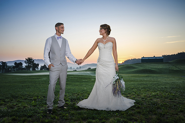 couple holding hands in a suit and wedding dress for wedding picture